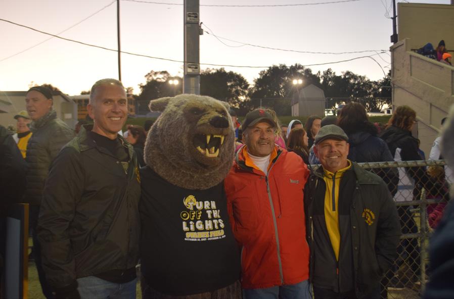 The Turner mascot poses with turner alumni.