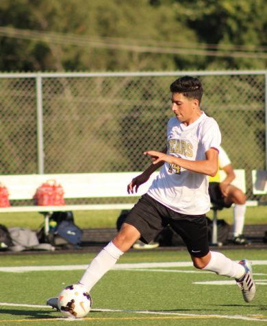 Sophomore Martin Figueroa goes for a kick during a match against Washington. Photo courtesy of Ester SenLing.