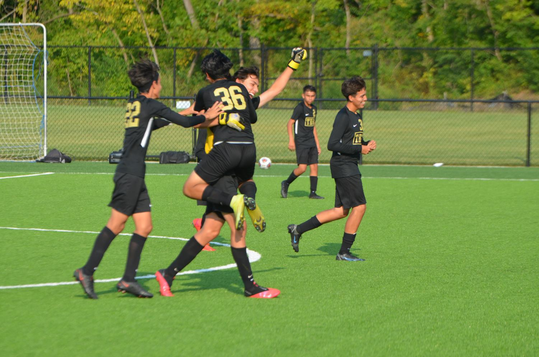 Freshmen Arnulfo Ibarra, scores a goal against Washington High School and celebrates with his team.